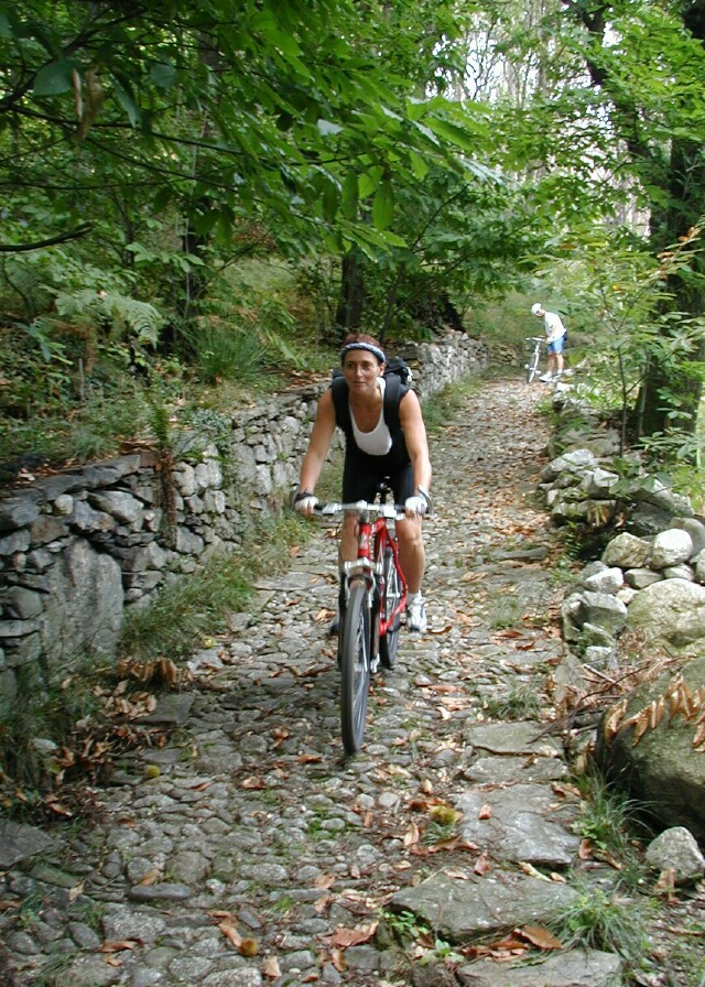 nancy-biking-on-cobble-path.jpg